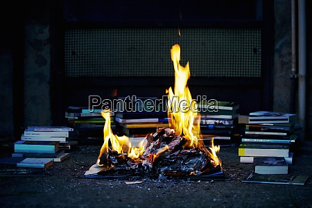 stack of books fire burning books