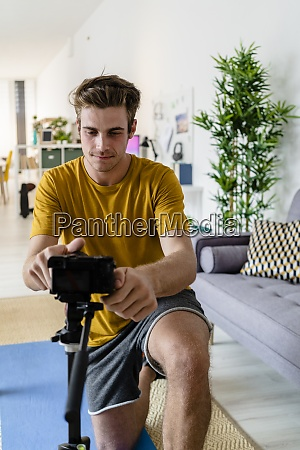 fitness trainer adjusting camera for live