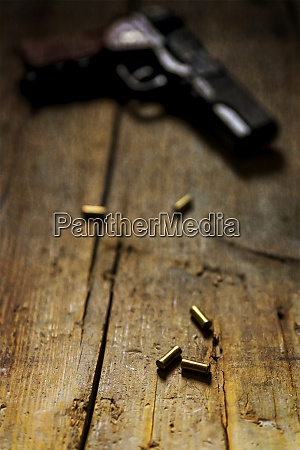 revolver and cartridges on wood
