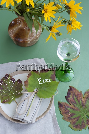 wineglass with water vase with blooming