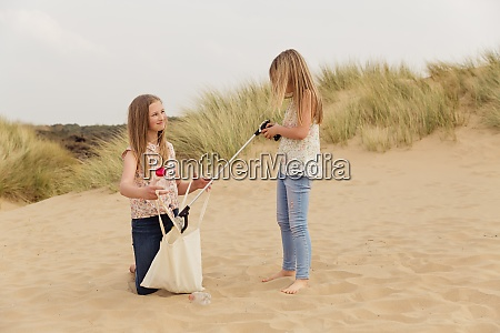 two girls with a bag on