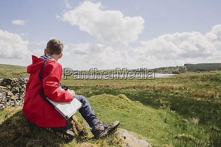 boy with map looking at view