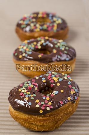 row of three american cronuts with