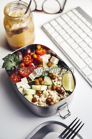 lunch box with fresh vegan salad