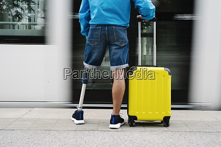young man with artificial limb and