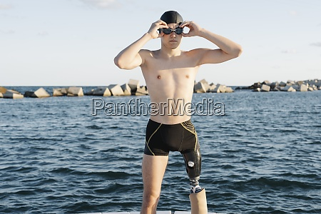 amputee male wearing swimming goggles while