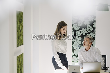 businesswoman and man having discussion at