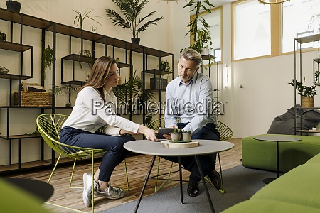 businessman and woman working together on