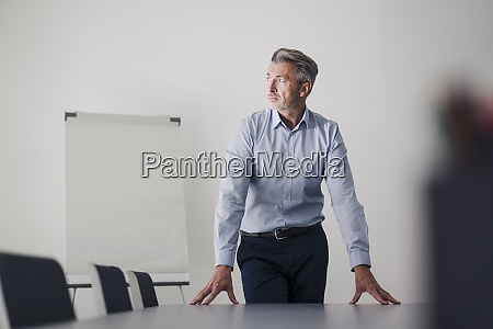 businessman with hands on table standing