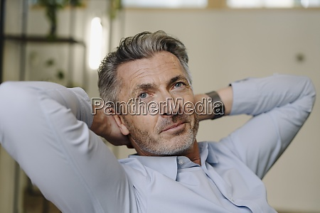 businessman with hands behind head relaxing