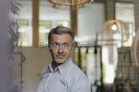 handsome businessman looking away while standing