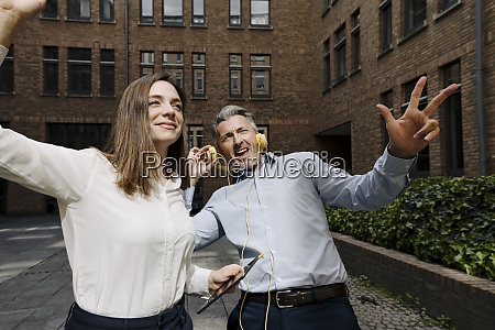 business people dancing and listening music