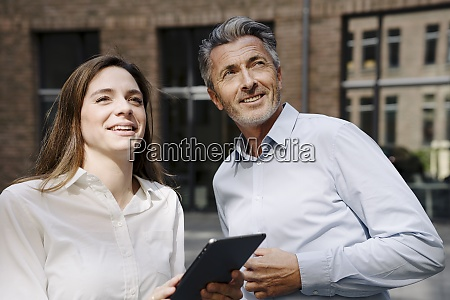 business people looking up while using