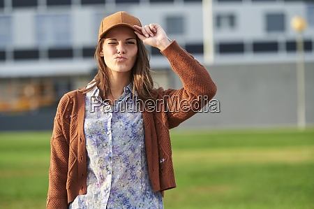 young woman doing pout while standing