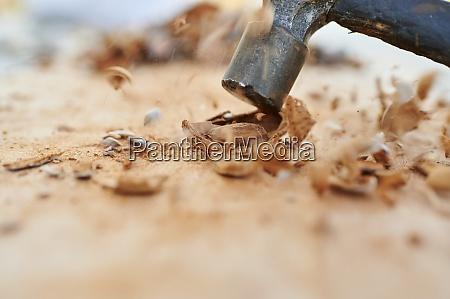 hammer breaking almond husk