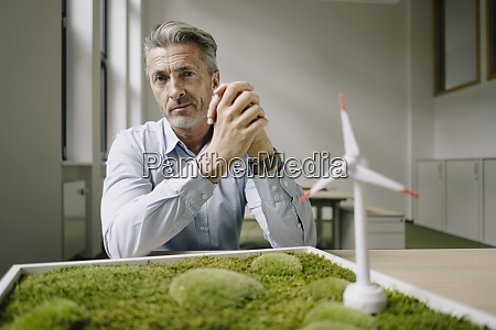 businessman, with, hands, clasped, sitting, by - 29119546