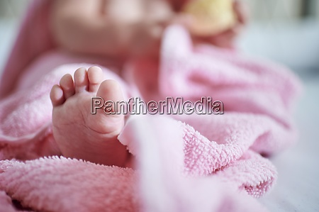 baby girl with barefoot in pink