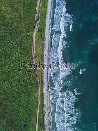 aerial view of dirt road stretching