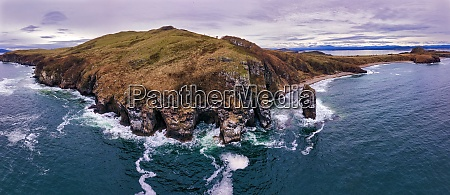 drone shot of cliff by sea