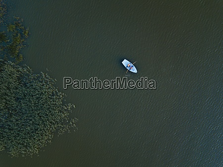aerial view of boat in lake