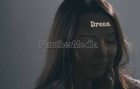 woman with the word dream projected