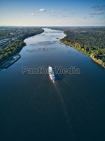 ship moving along volga river against