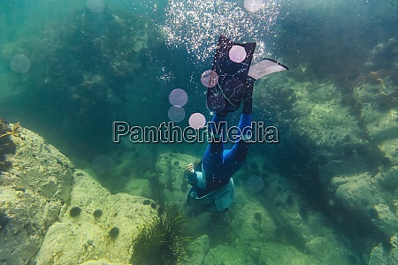 mid adult woman wearing diving suit