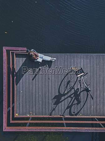 aerial view of young woman reading