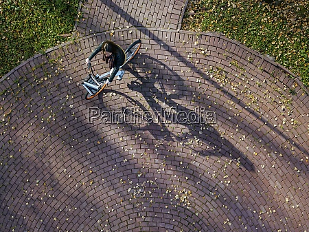aerial view of young woman riding