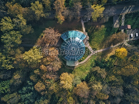 drone view of structures amidst trees