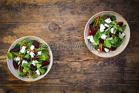 two bowls of vegetarian salad with