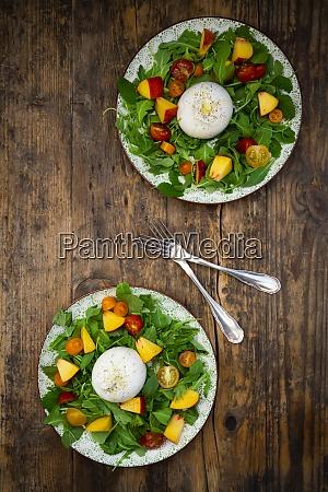 two plates of fresh vegetarian salad