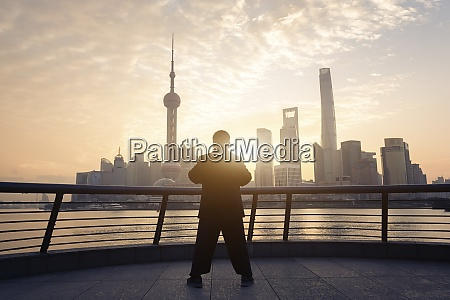 china shanghai skyline with person doing