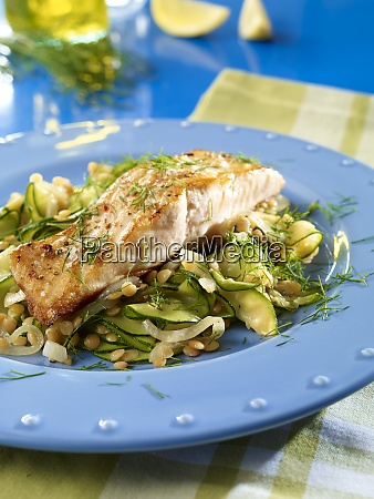 fried salmon steak with lentils and