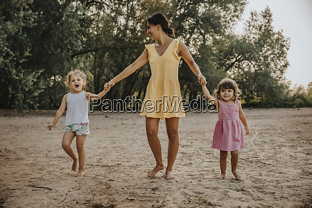 mother and daughter holding hands while