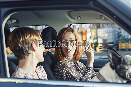 two female friends sitting in their