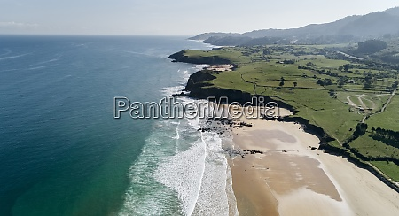 aerial view of sandy coastal beach