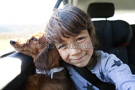 portrait of smiling little boy sitting