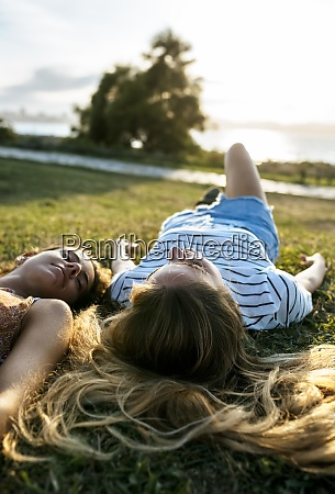 young women relaxing on field during