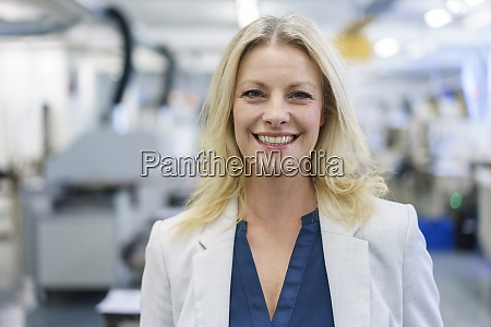smiling mature blond female professional standing
