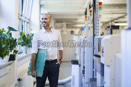 smiling male engineer looking away while