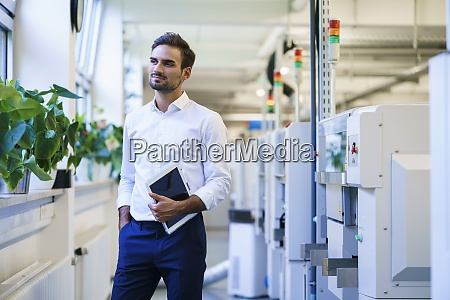 young businessman holding digital tablet while