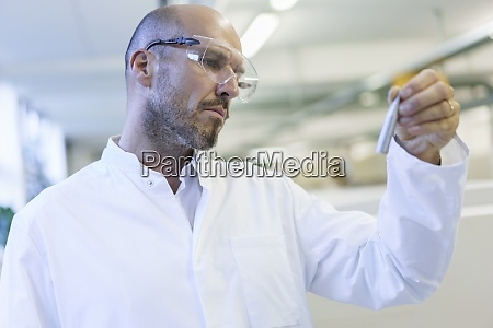 mature male technician wearing protective eyewear