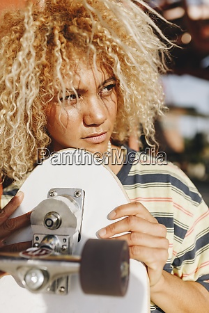 hispanic woman with blond curly hair