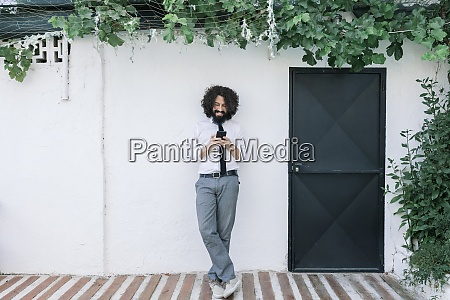 businessman using mobile phone while standing