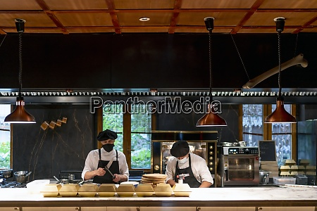 chefs wearing protective face mask standing