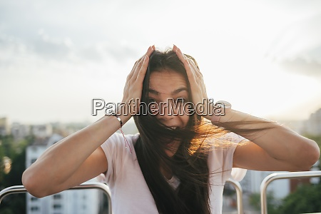 excited young woman with head in