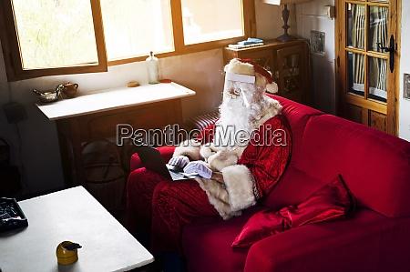 man wearing santa claus costume using