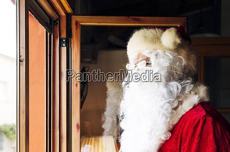 man wearing santa claus costume looking
