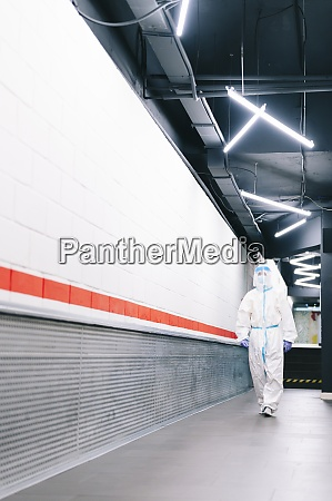 mid adult man walking in corridor
